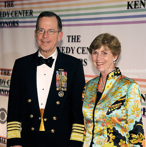 Washington, DC - December 2, 2007 -- Chairman of the Joint Chiefs of Staff Admiral Mike Mullen (L) and his wife Deborah arrive at the John F. Kennedy Center for the Performing Arts for the gala performance honoring the 30th Annual Kennedy Center honorees in Washington, D.C. on Sunday, December 2, 2007. The honorees for 2007 are: Leon Fleischer, Steve Martin, Diana Ross, Martin Scorsese, and Brian Wilson..Credit: Ron Sachs / CNP