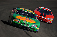 Oct. 10, 2009; Fontana, CA, USA; NASCAR Nationwide Series driver Morgan Shepherd leads Derrike Cope during the Copart 300 at Auto Club Speedway. Mandatory Credit: Mark J. Rebilas-