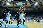 11 November 2012: North Carolina's Danielle Butts (10) grabs a rebound over Duquesne's Belma Nurkic (23). The University of North Carolina Tar Heels played the Duquesne University Dukes at Carmichael Arena in Chapel Hill, North Carolina in an NCAA Division I Women's Basketball game, and a quarterfinal in the Preseason WNIT. UNC won the game 62-58