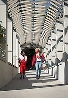 Marty Guerero '16 and Emma Cecilia Shahriari '18 walk from the Samuelson Campus Pavilion (Tiger Cooler) on Nov. 3, 2015.<br />