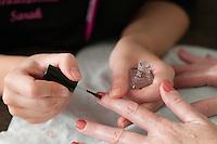 Painting fingernails, Beauty Department, Sussex Downs College, Lewes, East Sussex.
