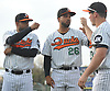 Newly signed Long Island Ducks pitcher Francisco Rodriguez #57, left, and Carlos Pimentel #26, center, greet teammate Travis Snider #23 during pregame introductions that preceded the team's season home opener against the Southern Maryland Blue Crabs at Bethpage Ballpark in Central Islip, NY on Friday, May 4, 2018.
