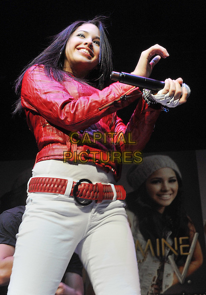 "JASMINE VILLEGAS.Teen R&B and pop singer JASMINE VILLEGAS performs as opening act to a SOLD OUT crowd at a stop on Justin Bieber's  ""MY WORLD TOUR 2010"" held at the Consol Energy Center, Pittsburgh, PA, USA..December 13th, 2010.stage concert live gig performance music half length white jeans denim red leather jacket belt hands arms.CAP/ADM/JN.©Jason L Nelson/AdMedia/Capital Pictures."