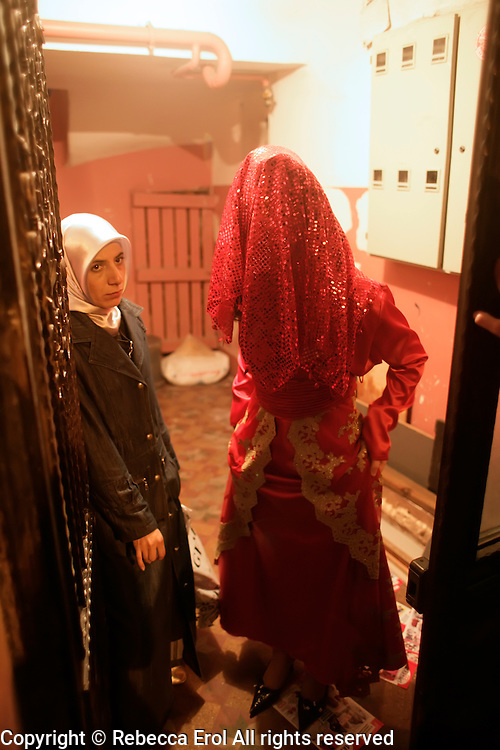 Bride waiting to leave her apartment building for the wedding celebrations or kina gecesi in Istanbul, Turkey