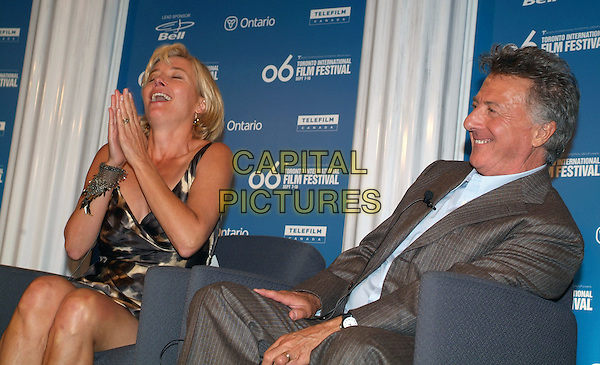 """EMMA THOMPSON & DUSTIN HOFFMAN.""""Stranger Than Fiction"""" Press Conference during the 2006 Toronto International Film Festival held at Sutton Place Hotel, Toronto, Ontario, Canada..September 9th, 2006.Ref: ADM/BP.half length pinstripe grey gray jacket laughing bracelet hands together clapping praying.www.capitalpictures.com.sales@capitalpictures.com.©Brent Perniac/AdMedia/Capital Pictures."""