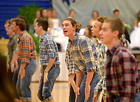 NWA Democrat-Gazette/BEN GOFF @NWABENGOFF<br /> Harrison Heffley, senior, and the Rogers High FX Show Choir perform on Friday Sept. 18, 2015 during the homecoming ceremony at Rogers High School.
