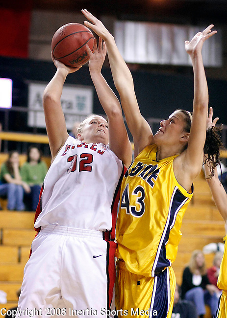 VERMILLION, SD - FEBRUARY 28 -- Bridget Yoerger #32 of the University of South Dakota gets partially blocked by Ashley Holiday #43 of Augustana College during their game Thursday evening at the DakotaDome in Vermillion, S.D. (Photo by Dick Carlson/Inertia)