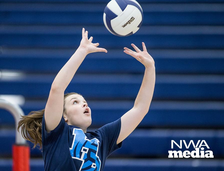 NWA Democrat-Gazette/BEN GOFF @NWABENGOFF<br /> Lauren Cloud, Springdale Har-Ber senior, sets the ball Thursday, Aug. 9, 2018, during volleyball practice at Wildcat Arena in Springdale.