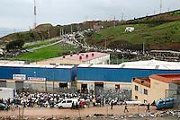 Il centro commerciale di Las Naves nei pressi di Ceuta; El Biutz, la strada che costituisce il punto di passaggio illegale delle merci tra Ceuta e il Marocco; sulla collina, il cosidetto Macro del commercio, punto di arrivo in Marocco dei portatori. Ceuta, 8 febbraio, 2010<br /> <br /> Las Naves shopping mall near Ceuta border; El Biutz, the illegal goods passage beetwen Ceuta and Morocco; On the top of the hill the &quot;macro of trade&quot;, bearers destination in Morocco. Ceuta, February 8, 2010