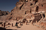 Bedouin passing through a colonnaded courtyard in the ancient Jordanian city of  Petra. Petra is the most visited tourist attraction in Jordan, a symbol of the country for its historical and archaeological importance. It has been a UNESCO World Heritage Site since 1985.