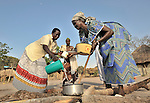 Women cooking in the Southern Sudan village of Yondoru. Families here are rebuilding their lives after returning from refuge in Uganda in 2006 following the 2005 Comprehensive Peace Agreement between the north and south. NOTE: In July 2011, Southern Sudan became the independent country of South Sudan