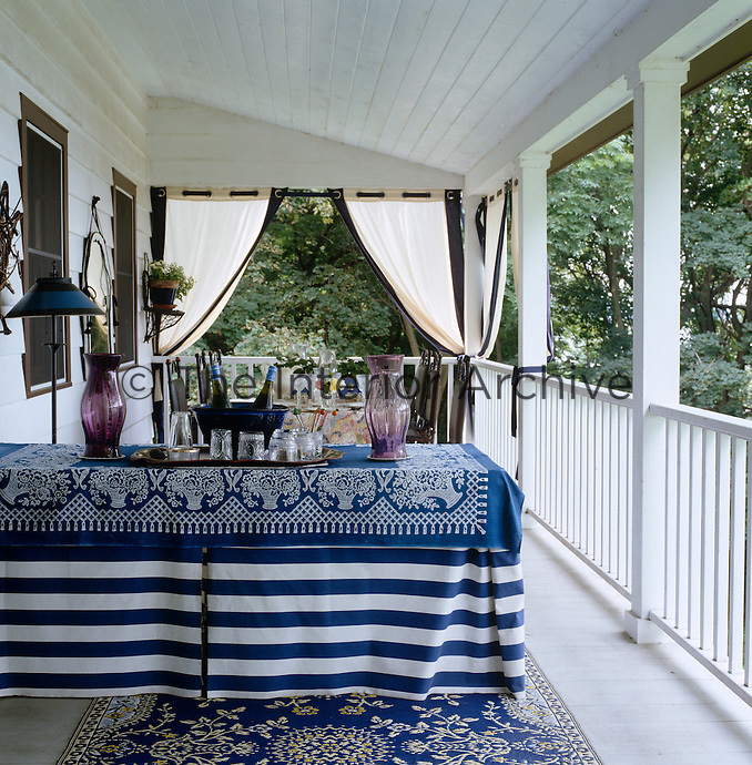 A table set for summer entertaining on the veranda