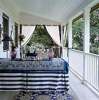 A table set for summer entertaining on the veranda