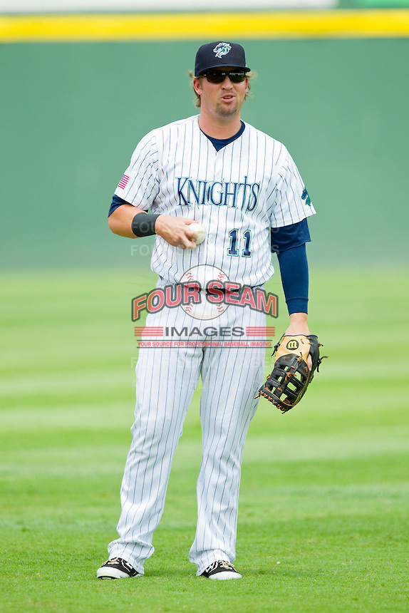 Charlotte Knights first baseman Andy Wilkins (11) warms up in the outfield prior to the game against the Gwinnett Braves at Knights Stadium on July 28, 2013 in Fort Mill, South Carolina.  The Knights defeated the Braves 6-1.  (Brian Westerholt/Four Seam Images)