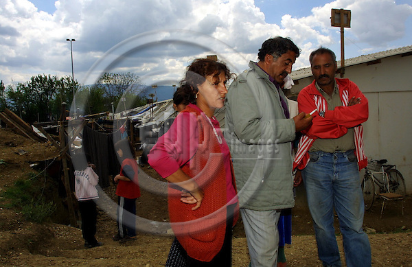 """MACEDONIA / SKOPJE, 10 MAY 2001--Kosovar Roman refugees in the refugee camp """"Suto Orizari"""" in the outscirts of Skopje. The Kosovar Romans, in the centre Berisha RAGIM with conpatriots fled to Macedonian during the Kosovo war and have been staying in the UNHCR refugee camp since the summer of 1999. Today in the camp are still around 1300 Kosovar Roman refugees. -- PHOTO: JUHA ROININEN / EUP-IMAGES"""