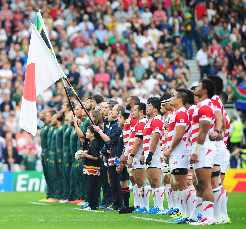 The teams line-up during the anthems<br /> <br /> Photographer Kevin Barnes/CameraSport<br /> <br /> Rugby Union - 2015 Rugby World Cup - Japan v South Africa - Saturday 19th September 2015 - The American Express Community Stadium - Falmer - Brighton<br /> <br /> &copy; CameraSport - 43 Linden Ave. Countesthorpe. Leicester. England. LE8 5PG - Tel: +44 (0) 116 277 4147 - admin@camerasport.com - www.camerasport.com