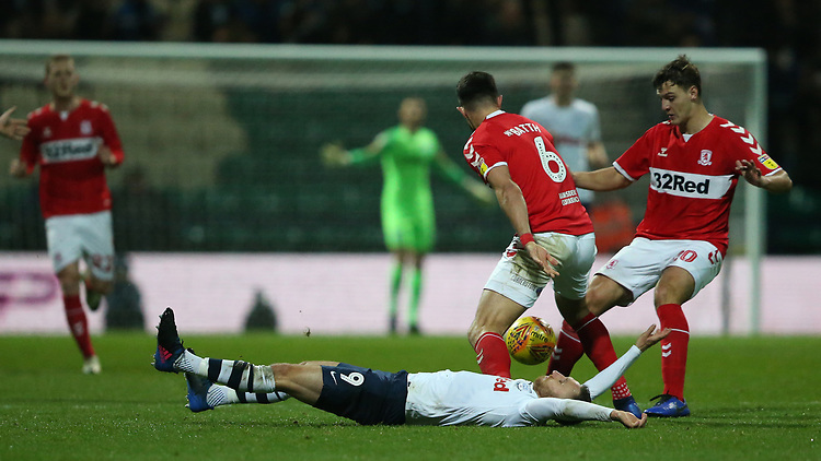 Preston North End's Louis Moult is bundled to the floor by Middlesbrough's Danny Batth (left)  and Dael Fry<br /> <br /> Photographer Stephen White/CameraSport<br /> <br /> The EFL Sky Bet Championship - Preston North End v Middlesbrough - Tuesday 27th November 2018 - Deepdale Stadium - Preston<br /> <br /> World Copyright © 2018 CameraSport. All rights reserved. 43 Linden Ave. Countesthorpe. Leicester. England. LE8 5PG - Tel: +44 (0) 116 277 4147 - admin@camerasport.com - www.camerasport.com