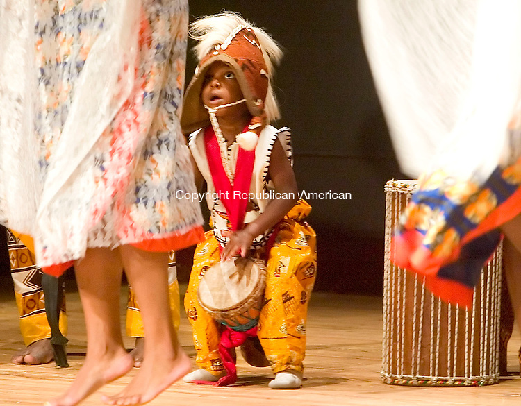 WATERBURY, CT- 30 DEC 06- 123006JT03- <br /> Rajuma Bey, 3, of Sounds of Afrika, watches the dancers in front of him during a Kwanzaa performance at Mattatuck Museum in Waterbury on Saturday afternoon.<br /> Josalee Thrift Republican-American
