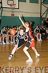 Maura Guiney St Paul's goes round Aisling O'Neill Killester in the Senior Women's National Cup semi final at the Parochial Hall, Cork on Saturday