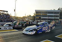 Oct. 5, 2012; Mohnton, PA, USA: NHRA funny car driver Robert Hight (near lane) races alongside his boss John Force during qualifying for the Auto Plus Nationals at Maple Grove Raceway. Mandatory Credit: Mark J. Rebilas-