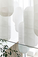 This contemporary house is an exercise in purity and harmony, where restraint and bleached colour allow simplicity and custom-made comfort to come to the fore as a luxury. The long white lanterns hanging in the double-volume entrance were specially commissioned and are handmade out of paper.
