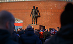Rangers fans gather outside the Stadium at the John Greig statue for the minutes silence in memory of the disaster