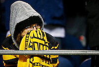 A Pittsburgh Steelers fan reacts following an 80-yard touchdown pass by the Seattle Seahawks in the fourth quarter during the game at CenturyLink Field on November 29, 2015 in Seattle, Washington. (Photo by Jared Wickerham/DKPittsburghSports)