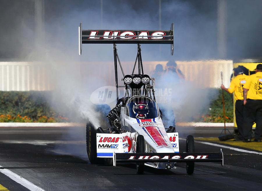 Feb 12, 2016; Pomona, CA, USA; NHRA top fuel driver Richie Crampton during qualifying for the Winternationals at Auto Club Raceway at Pomona. Mandatory Credit: Mark J. Rebilas-USA TODAY Sports