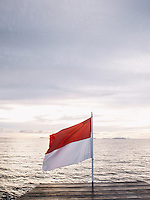 The Indonesian flag at the top deck of Alila Purnama, the Bugis crafted traditional wooden Phinisi boat.