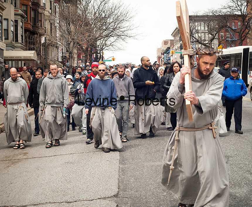 Parishioners and clergy members from the  Franciscan Friars of the Renewal gather in Harlem in New York for their annual Way of the Cross Witness Walk on Good Friday, April 18, 2014. The procession starts at St. Joseph's Friary in Harlem and ends several hours later at the St. Crispin Friary in the Bronx where a Good Friday service takes place. Several hundred parishioners as well as clergy participated in the event, part of Holy Week,  which commemorates the crucifixion of Jesus Christ. (© Richard B. Levine)