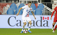 TORONTO, ON - OCTOBER 15: Christian Pulisic #10 of the United States moves with the ball during a game between Canada and USMNT at BMO Field on October 15, 2019 in Toronto, Canada.