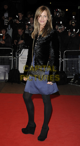 "TRINNY WOODALL .The premiere of ""Anvil! The Story Of Anvil"" during the Times BFI 52nd London Film Festival, at the Odeon West End, London, England, .October 21st, 2008.LFF full length black fur jacket blue dress Chanel bag cross body chain strap tights suede shoes wedges .CAP/CAN.©Can Nguyen/Capital Pictures."
