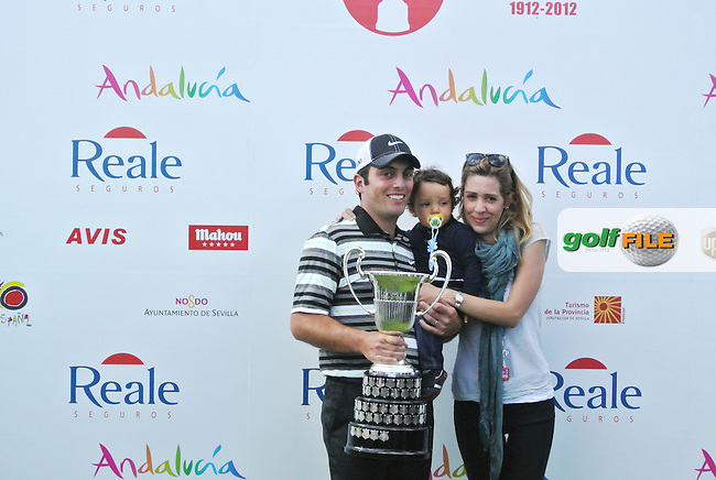 Francesco Molinari (ITA) with wife Valentina and son Tommaso after winnning Sunday's Final Round of the Open de Espana at Real Club de Golf de Sevilla, Seville, Spain, 6th May 2012 (Photo Fathia Tour Miss/www.golffile.ie)