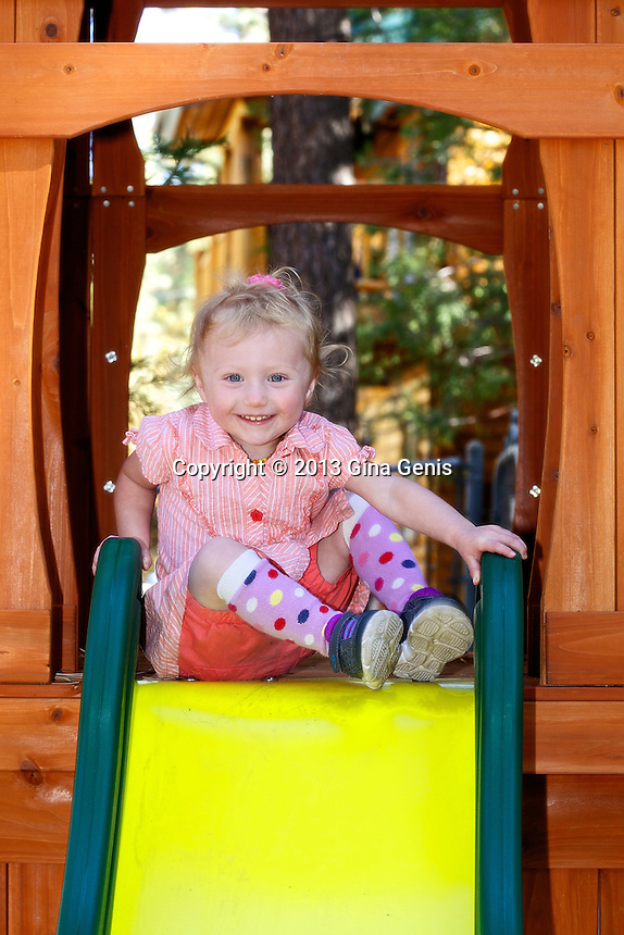 Opal Larkin on her slide in the back yard of her house on Idyllbrook