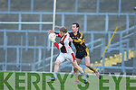 Rathmore keeper Jamie Cooper breaks away from Currow forward Daniel O'Shea during their O'Donoghue cup semi final in Fitzgerald Stadium on Sunday