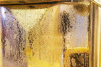 The winery with stainless steel fermentation tanks. Detail of one of the doors. The tank is wet with condensation since the wine inside is chilled. detail of the water drops with reflections Chateau Thieuley La Sauve Majeure Entre-deux-Mers Bordeaux Gironde Aquitaine France