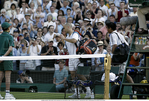 ANDRE AGASSI (USA) after being defeated by Srichaphan  Men's Singles  Round 2, Wimbledon 2002, 020626 Photo:Glyn Kirk/Action Plus...Tennis.The Championships.man.