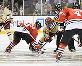 Mike McLaughlin (Northeastern - 18), Bill Arnold (BC - 24), Scott Hansen - The Boston College Eagles defeated the Northeastern University Huskies 7-1 in the opening round of the 2012 Beanpot on Monday, February 6, 2012, at TD Garden in Boston, Massachusetts.