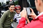 Jarlinson Pantano (COL) Trek-Segafredo poses for a photo with a fan outside the team bus in Dusseldorf before the start of Stage 2 of the 104th edition of the Tour de France 2017, running 203.5km from Dusseldorf, Germany to Liege, Belgium. 2nd July 2017.<br /> Picture: ASO/Alex Broadway | Cyclefile<br /> <br /> <br /> All photos usage must carry mandatory copyright credit (&copy; Cyclefile | ASO/Alex Broadway)