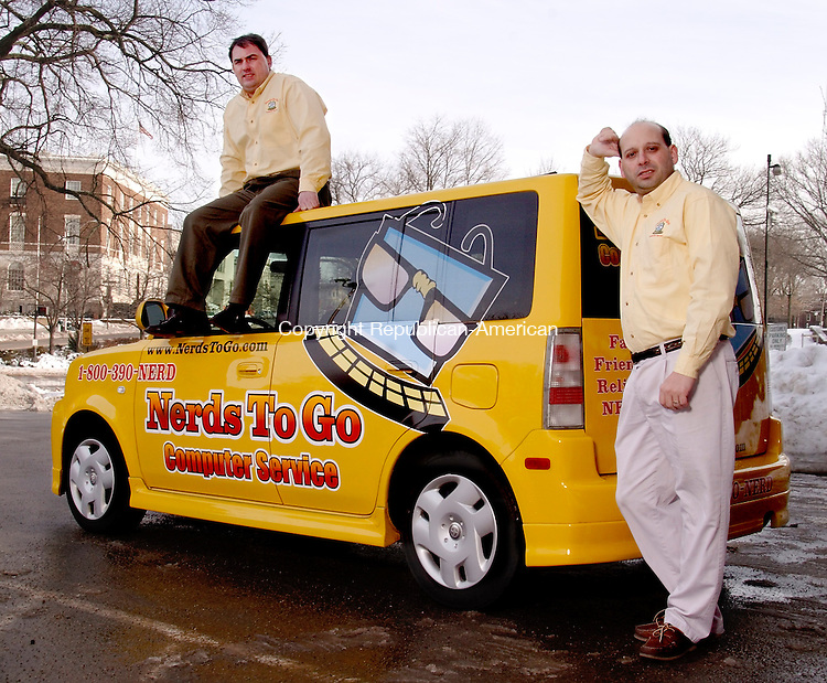 WATERBURY, CT - 7 JANUARY 2005 -010705BF01 -- David J. Colella, left, senior vice president, and John Colucci, Waterbury area technician, show the corporate vehicle for NerdsToGo, a computer servicing business based in Guilford. Colella and his wife, Kristina, founded the company two years ago and are expanding it to the Waterbury area.   Bob Falcetti Photo
