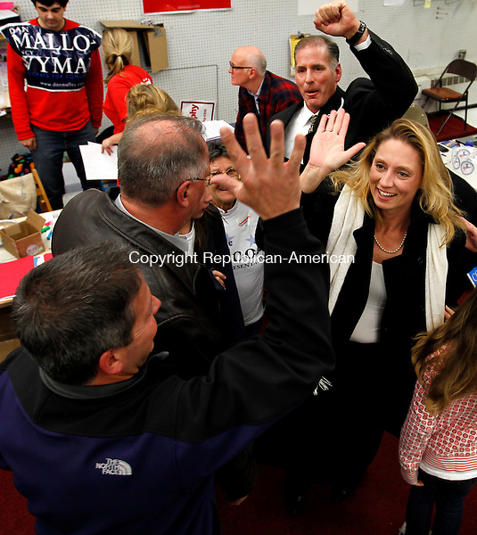 Torrington, CT- 02, November 2010-110210CM07  State Representative incumbent Michelle Cook (right), is congratulated by supporters as she enters the Torrington Democratic headquarters on East Main St. in downtown Torrington Tuesday night.  Cook defeated Republican challenger, Wendy Traub to maintain her seat in the CT House of Representatives.  Christopher Massa Republican-American