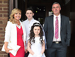 Faye Gillespie who received First Holy Communion in the Church of the Nativity Ardee pictured with parents Finbar and Barbara and brother Daniel. Photo:Colin Bell/pressphotos.ie