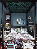 The Zandberg-designed four-poster bed fills the attic bedroom