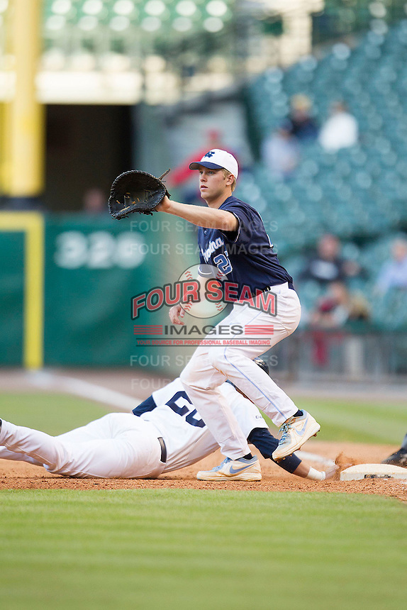 North Carolina Tar Heels first baseman Cody Stubbs #25 during a pick off attempt in the NCAA baseball game against the Rice Owls on March 1st, 2013 at Minute Maid Park in Houston, Texas. North Carolina defeated Rice 2-1. (Andrew Woolley/Four Seam Images).