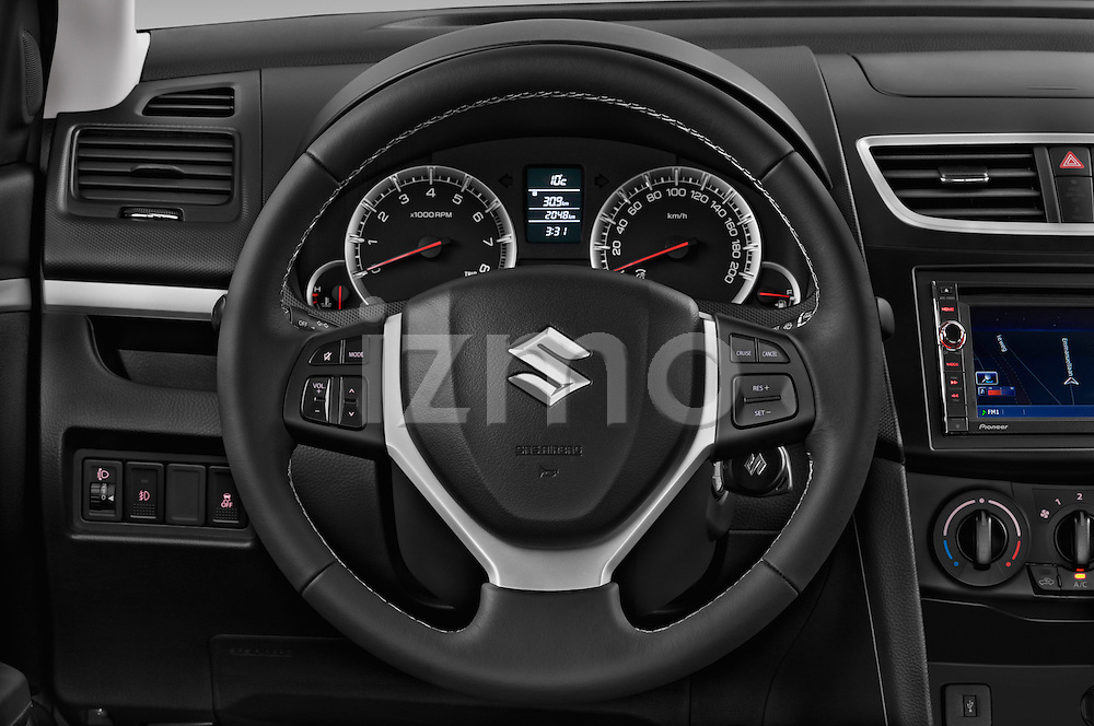 Car pictures of steering wheel view of a 2013 Suzuki SWIFT Grand Luxe @ttraction 5 Door Hatchback 2WD Steering Wheel