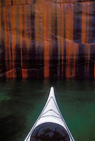 A sea kayak bow with the namesake mineral stains of Pictured Rocks National Lakeshore near Munising, Mich.