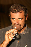 Herve Lamothe, owner and wine maker, tasting his wine in the cellar - Chateau Haut Bergeron, Sauternes, Bordeaux