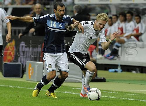 15.08.2012. Frankfurt, Germany.  Germany versus Argentina international friendly. In Picture Javeir Mascherano ARG  against Andre  ger