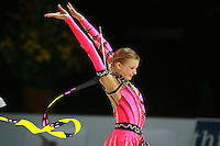 Olga Kapranova of Russia re-catches ribbon during All-Around competition at 2006 Thiais Grand Prix in Paris, France on March 25, 2006.  (Photo by Tom Theobald)