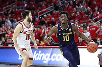 RALEIGH, NC - JANUARY 9: T.J. Gibbs #10 of the University of Notre Dame drives past Braxton Beverly #10 of North Carolina State University during a game between Notre Dame and NC State at PNC Arena on January 9, 2020 in Raleigh, North Carolina.